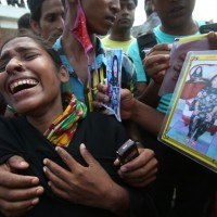 130501-bangladesh-building-collapse-bodies-mass-burial-07-farida-fahima