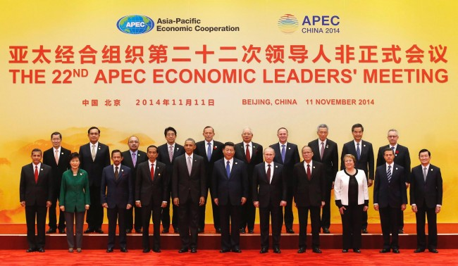 APEC leaders pose for a family photo at the International Convention Center at Yanqi Lake in Beijing